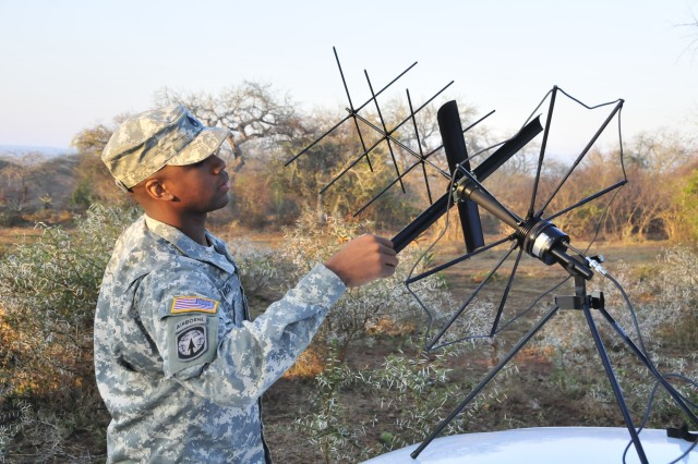 Army Staff Sgt. Jaime Green, U.S. Army Africa G-6, sets up a SatCom antenna for communications back to headquarters during a veterinary civil assistance project (VETCAP) as part of exercise MEDFLAG 09 in Hhohho Village, Swaziland, on Wednesday, August 5.