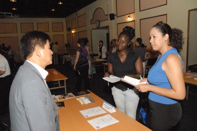 Family members search opportunities at job fair