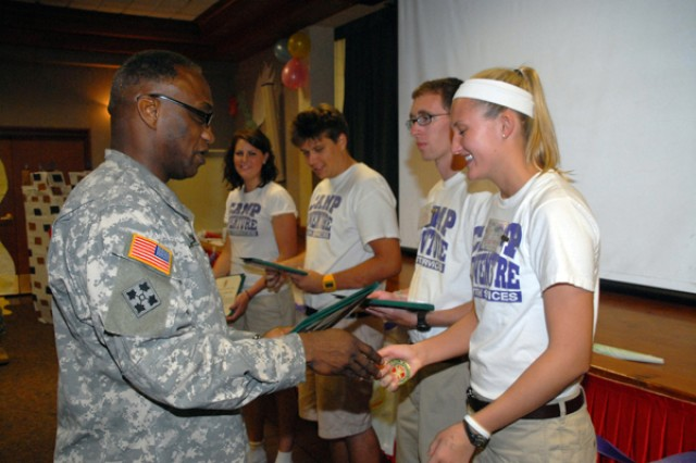 Camp Adventure counselors awarded certificates from commander
