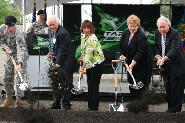(From left to right) Maj. Gen. Scott West, Congressman Sander Levin, TARDEC Director Dr. Grace M. Bochenek, Sen. Debbie Stabenow, and Sen. Carl Levin break ground on the Department of Defense's Ground System Power and Energy Lab Aug. 17, at Detroit Arsenal, Mich. When completed, the eight-labs-in-one complex will have testing capabilities unlike any other facility in the world.