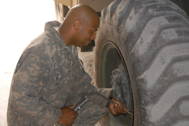 Pfc. Emory Ramey, a Rome, Ga., native and quartermaster chemical repair specialist with 15th Brigade Support Battalion, 2nd Brigade Combat Team, 1st Cavalry Division, refills the tire on a forklift in the ground support equipment section shop on Forward Operating Base Warrior, Kirkuk, Iraq, Aug. 11. The GSE shop performs all the maintenance for forklifts on the FOB, even though many of the mechanics in the shop never worked on forklifts before coming to Iraq.