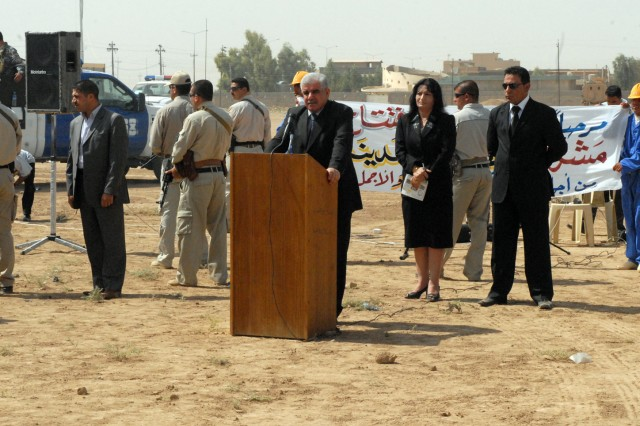 Kirkuk Governor Abdul Rahman Mustafa speaks to an audience during a ceremony in Kirkuk city, Iraq, August 9, celebrating the beginning of a two-month beautification project set to educate residents on proper waste disposal and remove trash and construction debris which have piled up around the city. The project was developed by the Kirkuk government with assistance from 3rd Battalion, 82nd Field Artillery Regiment, 2nd Brigade Combat Team, 1st Cavalry Division.