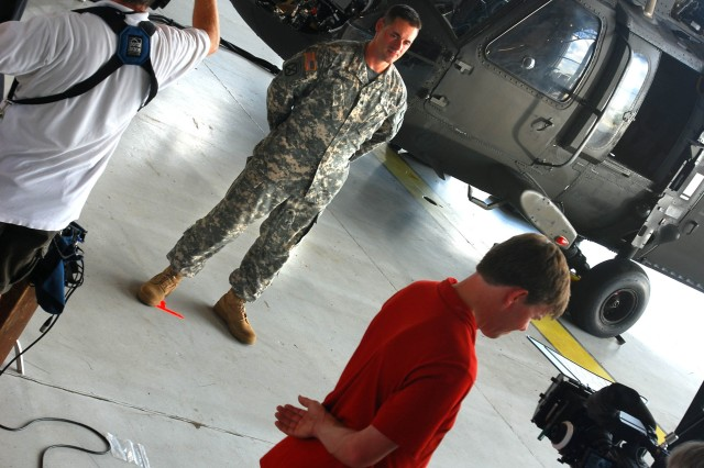 Sergeant Richard Schmidt, A Co., 2/3 Avn., 3rd CAB, 3rd ID, talks about his job as a Black Hawk mechanic and crew chief while filming a military occupational specialty video, Aug. 6 at Hunter Army Airfield.