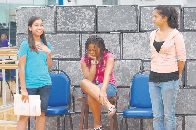 """Aurora Bonnette, 12; Alisha Edwards, 13; and Darian Abenes, 14, rehearse for the upcoming performance of """"Beauty is a Beast."""" The play will be featured along with a telent competition and acrobats during the Festival of the Arts, Saturday at 4 p.m. in Wallace Theatre."""