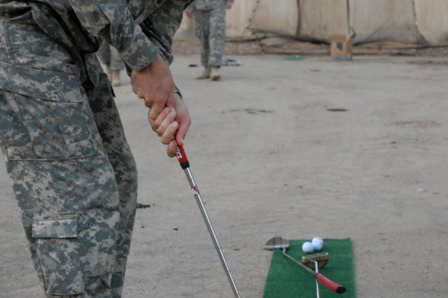 """BAGHDAD - Philadelphia native, Sgt. Maj. Robert Leimer, the plans sergeant major for the 1st Brigade Combat Team, 1st Cavalry Division, putts during the """"Fairways 2 Greens"""" Golf Tour at Joint Security Station War Eagle Aug. 18."""