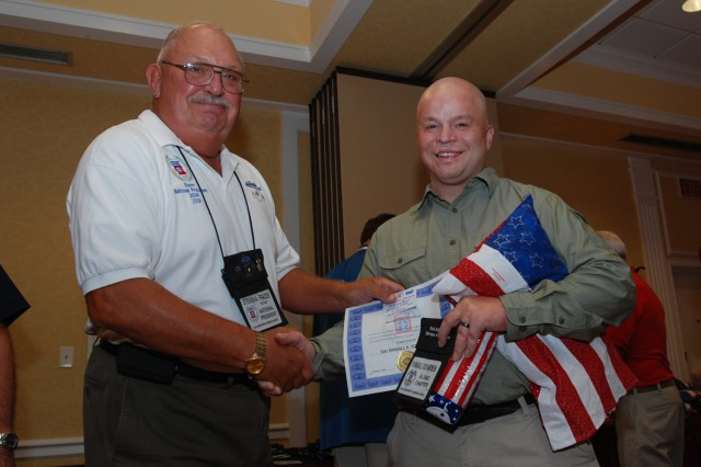 Steve Frazer (left) president of the 82nd Airborne Division Association, shakes hands with Staff Sgt. Randall K. Scharmen, 82nd Airborne Division Casualty Liaison, during a dinner honoring Purple Heart recipients from Iraq and Afghanistan that was part of the Association's 63rd National Convention in Indianapolis, Ind. Aug. 19 - 22. Scharmen and 41 other wounded warriors were flown free of charge to Indianapolis by the association's members to take part in the convention. (U.S. Army photo by Staff Sgt. Mike Pryor, 2nd BCT, 82nd Abn. Div. Public Affairs)