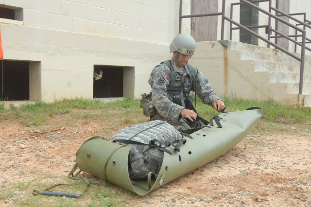 A competitor prepares a rescue system to evacuate a casualty as part of a skill test during the Best Warrior Competition.