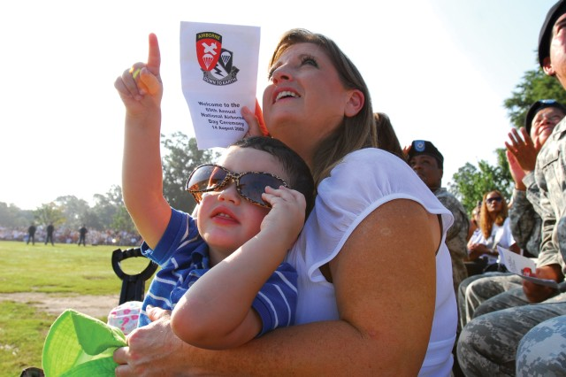 Kaden Perkins watches the skydiving demonstration with his grandmother, Diane Ryals.