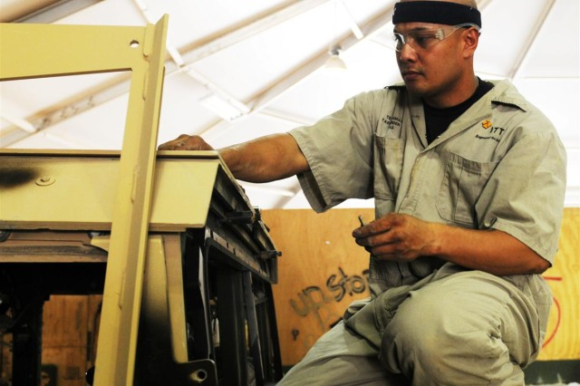 Fransisco Tarusan, a crewmember for ITT, begins the install of the Frag 7 kit on the M1151 Humvee at Joint Base Balad. Members of the team work 24 hours a day, six days a week to have the vehicles ready for units across Iraq.