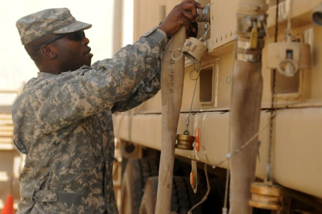 Pfc. Kashif McCormick, a Springhill, Fla., native, and ROWPU operator with the 102nd QM Co., attaches hoses thats direct raw water into the ROWPU where it is then purified and treated into potable water.