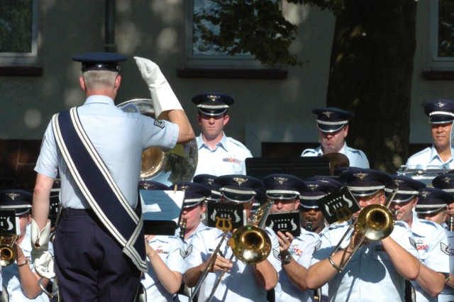 The U.S. Air Force Europe Band, led and conducted by Tech Sgt. Dodd Martin, performed a musical tribute to Maj. Gen. Yves J. Fontaine, the former commanding general of the 21st Theater Sustainment Command. Marking representative assignments of Fontaine's career, the band played the songs of the 4th Infantry Division, the 24th Infantry Division, the 82nd Airborne Division, the 1st Corps Support Command, the 21st TSC and the Army Song.