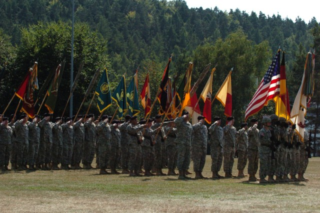 The colors of all the 21st Theater Sustainment Command's units are dipped low while the national colors of Germany and the United States stand tall during the playing of the German and American National Anthems at the 21st TSC's change of command ceremony Aug 20.