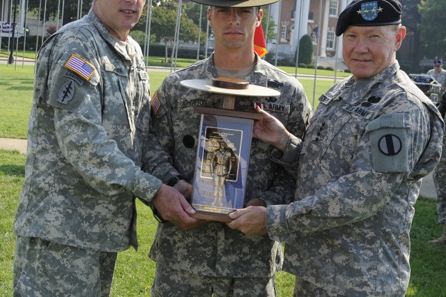 Staff Sgt. Michael Johnston from Fort Benning, Ga., earned the title of active-duty 2009 Drill Sergeant of the Year. Johnston received the Drill Sergeant of the Year trophy from Command Sgt. Maj. David Bruner and Gen. Martin E. Dempsey of the U.S. Army Training and Doctrine Command.