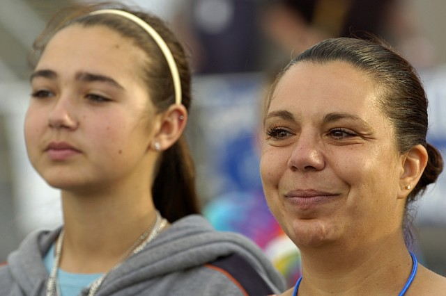 With tears welling in her eyes, Dana Shearon and daughter Caitlin, 15, look on as the name of their brother and uncle, Cpl. Gennaro Pellegrini Jr., is read over the public address system.  Pellegrini was killed in action Aug. 9, 2005.