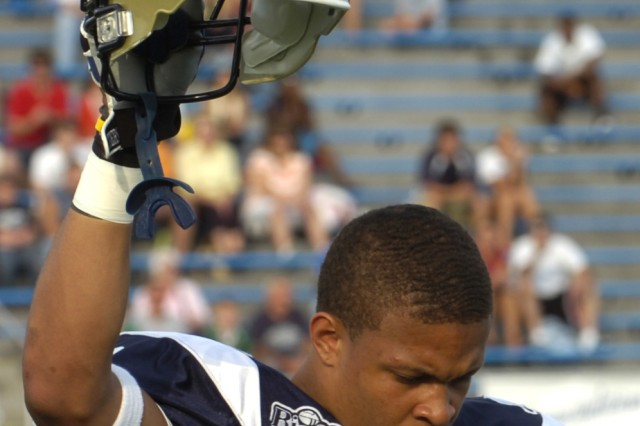 With head bowed in a solemn salute, Malik Generett, a wide receiver bound for the University of Connecticut, pays respect as the name of Sgt. Sherwood Baker echoes throughout a silent stadium. Baker was the first of 34 Soldiers from the Pennsylvania National Guard killed in action during the wars in Afghanistan and Iraq.