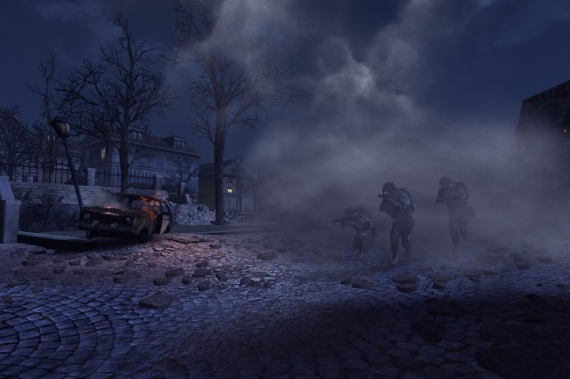 Soldiers emerge from the concealment of a smoke grenade on the Bridge map.