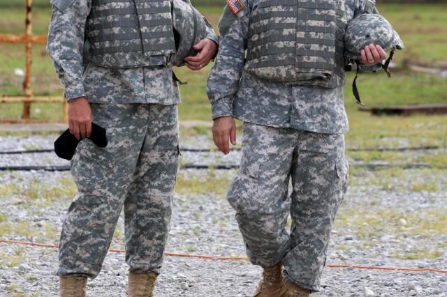 Maj. Gen. Jim Myles and Brig. Gen. Genaro Dellarocco have reason to smile at their Javelin missile firing Aug. 10.