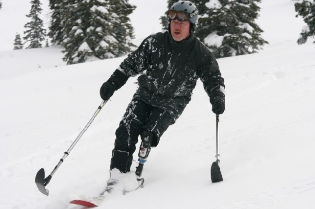 Lt. Col. (Ret.) Dennis Walburn, who lost his left leg to an improvised explosive device during a tour in Iraq, demonstrates his adaptive skiing skills at Steamboat Springs, Colo., in January. Walburn underscores the need to find jobs for Wounded Warriors as a way to help them get back into the workforce.