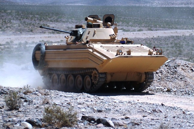 A visually-modified M113 rolls through the Mojave Desert at the National Training Center on Fort Irwin, Calif. The 11th Armored Cavalry Regiment's visually-modified vehicles will once again be employed during force-on-force combat training. The vehicles will be used as part of hybrid threat warfare which uses both conventional military assets as well as insurgency operations.