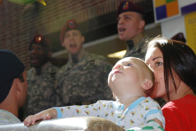 Eleven-month-old Dylan grooves to the music while listening to a performance by Paratroopers from the 82nd Airborne Division Chorus at the Riley Hospital for Children in Indianapolis, Ind., Aug. 21. The chorus performed songs and visited children at two area children's hospitals while in town for the 82nd Airborne Division Association Convention held Aug. 19-22.