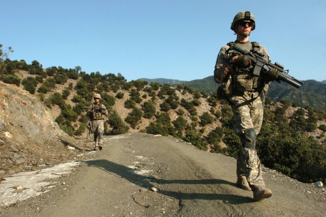 KUNAR PROVINCE, Afghanistan - U.S. Army Soldiers from Company B, 2nd Battalion, 12th Infantry Regiment, patrol the Korengal valley, in Afghanistan's Kunar province, Aug. 18. The 4th Brigade Combat Team, 4th Infantry Division Soldiers have been battling insurgents in the valley since arriving in June. (Photo by U.S. Army Sgt. Matthew Moeller, 5th Mobile Public Affairs Detachment)