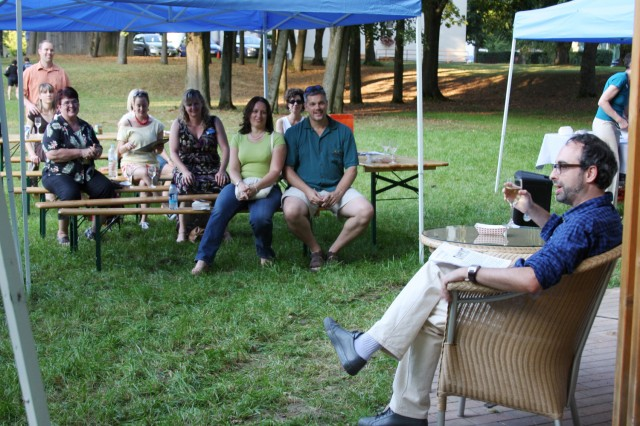 """Gary Shteyngart, right, notable author of novels and travel pieces, reads to community members during a writer's workshop held at U.S. Army Garrison Schweinfurt, Germany. The workshop, consisting of a poetry jam, a question and answer session, book readings and signings, was part of the """"Conversations"""" series for Army Europe Libraries."""