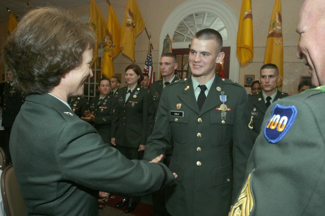 Brig. Gen. Patricia Heritsch, 100th Division commander, congratulated Pfc. Joshua Cole, HHC, 100th Division, after he was named the 80th Training Command Soldier of the Year.