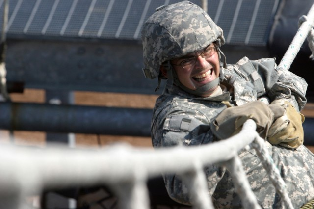 Sgt. 1st Class Kenneth Ashenfelter, a military police officer from the 102nd Training Division from Adrian, Mich., tackled the two-rope bridge on his way to the rappel tower.