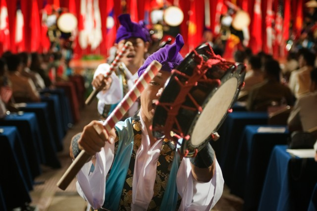 Members of the 1st Combined Brigade, Japan Ground Self Defense Force, perform the Eisa Dance, a traditional dance of Okinawa, during the opening ceremony of PACC/PAMS, Aug. 24, 2009.