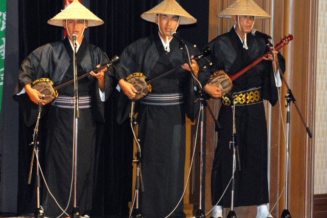 Members of the 1st Combined Brigade, Japan Ground Self Defense Force, play the shamisen during the cultural event as part of the opening ceremony for the Pacific Armies Chiefs Conference and Pacific Armies Management Seminar, Aug. 24, 2009.