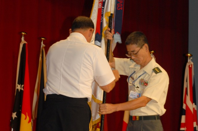Lt. Gen. Toshiyuki Morotomi, commanding general, Japan Ground Self-Defense Force Research and Development Command, and Lt. Gen. Benjamin R. Mixon, commanding general, United States Army, Pacific, post the colors during the opening ceremony of the 33rd Pacific Armies Management Seminar, Aug. 24, 2009.