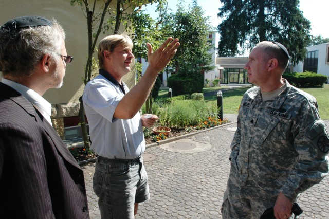 Chaplain (Lt. Col.) Avi Weiss confers with administrator Gerhard Honikl, center and Rabbi Mordechai Pavlovsky at the Max-Willner-Heim in Bad Sobernheim, Germany, the site of the upcoming Rosh HaShanah retreat.