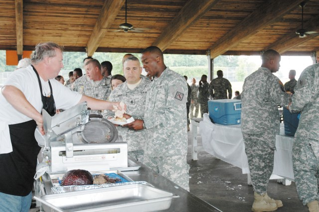 Senior noncommissioned officers like Sgt. 1st Class Dione Allston, right and 1st Sgt. Michael Grui, second from right, of the 22nd Chemical Battalion (Technical Escort) waited for lower enlisted Soldiers to eat before being served their lunch at Capa Field during the AUSA 2nd Annual Soldier Appreciation Picnic July 21.