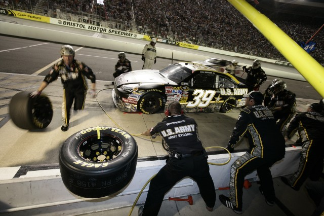 The Army pit crew changes two tires on the Army Chevy Impala following a caution for light rain on Lap 422 of the Sharpie 500 Saturday night. While most teams changed four tires, the two-tire strategy helped propel the Army team to a sixth-place finish.