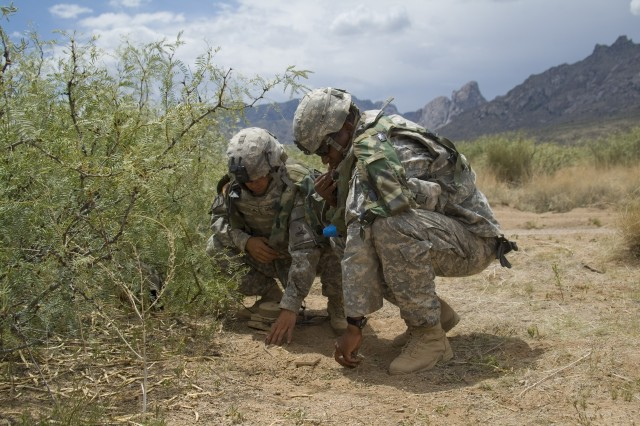 Senior scout Staff Sgt. Errol Caldwell (right) and his gunner Sgt. Micheal Gimble (left) from the 2nd Combined Arms Battalion place a Tactical Unattended Ground Sensor during test exercises held on Fort Bliss, Texas, and White Sands Missile Range, N.M. The shape of the T-UGS was changed after receiving feedback from the Soldiers using it. The new version seen here is easier to place and has better range and capabilities then before.