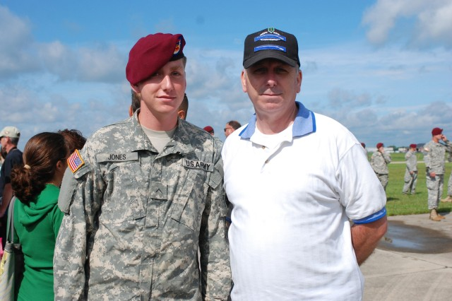 Pvt. Patrick Jones, 1st Squadron, 73 Cavalry Regiment, stands with his father, Alan, at Mt. Comfort Airfield in Indianapolis on August 20. Troopers were flown to the airfield by C-130s to kick off the 63rd Annual 82nd Airborne Division Convention. (U.S. Army photo by Pfc. Kissta M. Feldner, 2BCT, 82D ABN DIV, PAO SPC)