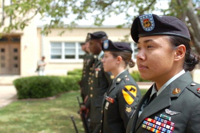 The rifle detachment stands ready to fire three volleys during the memorial service of Spc. Lucas Bregg at the 1st Cavalry Division Chapel Aug. 20. The tradition of firing three rifle volleys signifies the Army taking care of their departed. Bregg served as a rifleman with the 2nd Battalion, 5th Cavalry Regiment, 1st Brigade Combat Team, 1st Cav. Div. He died from injuries from a non-combat related incident July 8 in Baghdad.