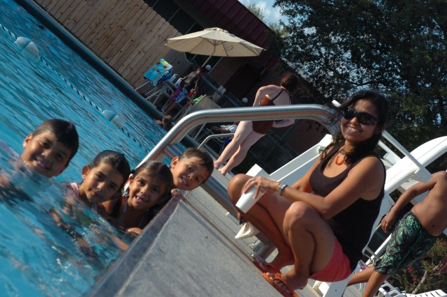 (From left to right) Gabriel 10 years-old, Daniela 8 years-old, Melinda 6 years-old, Andre 4 years-old and Mariana Dionne line up along the edge of the West Fort Hood swimming pool during 3rd Brigade Special Troop Battalion, 1st Cavalry Division, end of summer pool party.