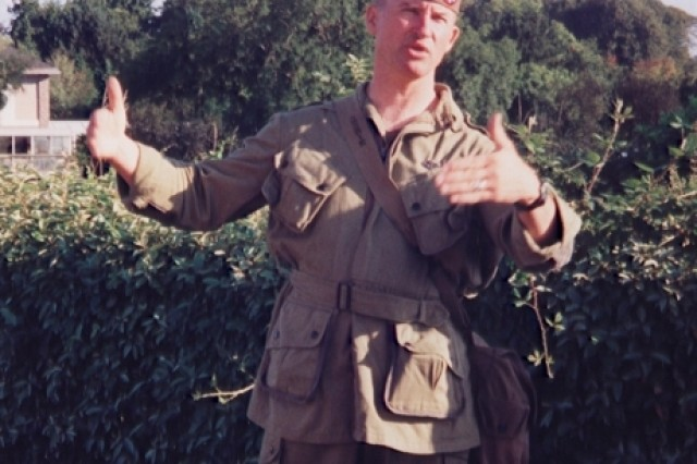 Steve Mrozek, former historian for the 82nd Airborne Division Association, lectures about D-Day in his souvenir World War II paratrooper's uniform.