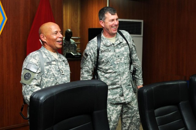 Maj. Gen. Luis R. Visot, commanding general of the 377th Theater Sustainment Command out of  New Orleans, and Brig. Gen. Paul L. Wentz, commanding general, 13th Sustainment Command (Expeditionary), greet members at a conference at Joint Base Balad Aug. 20.