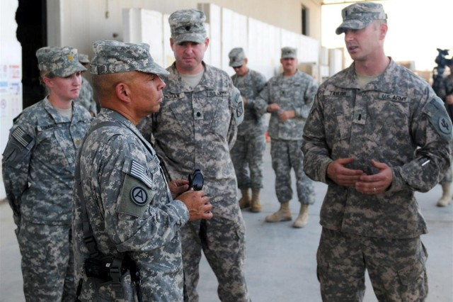Pictured from left to right: Maj. Michelle K. Donahue, 80th Ordnance Battalion, support operations officer, Maj. Gen. Luis R. Visot, commanding general, 377th Theater Sustainment Command, Lt. Col Chris Mohan, commander, 80th Ord. Bn. and 1st Lt. Spencer R. Taylor, Forward Redistribution Point accountable officer, 910th Quartermaster Company. Visot receives a brief from Taylor concerning accountable items at the FRP