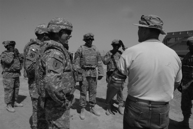 Allan Tiffany debriefs Brig. Gen. Paul L. Wentz, the commanding general with the 13th Sustainment Command (Expeditionary), and Soldiers with the Personal Security Detachment from the Washington Army National Guard's 547th Transportation Company, following Mine Resistant Ambush Protected vehicle rollover training. The PSD and their principles - the commanding general, the deputy commander, and the command sergeant major of the 13th ESC - conducted the training together to get to know each other here at Joint Base Balad Aug. 17