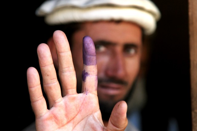 An Afghan elder shows his inked finger to show he voted during the heavily anticipated Afghanistan elections in Barge Matal, Afghanistan, Aug. 20, 2009. Afghanistan village elders are considered to be the role models and leaders among the Afghan civilians.