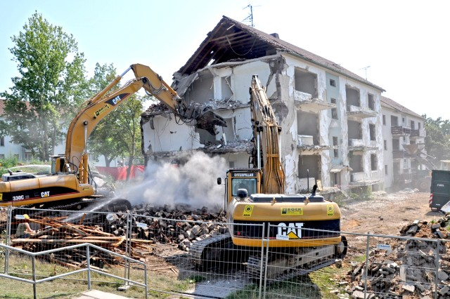 Workers take down one of four building in Wiesbaden's Hainerberg Housing in preparation for future projects.