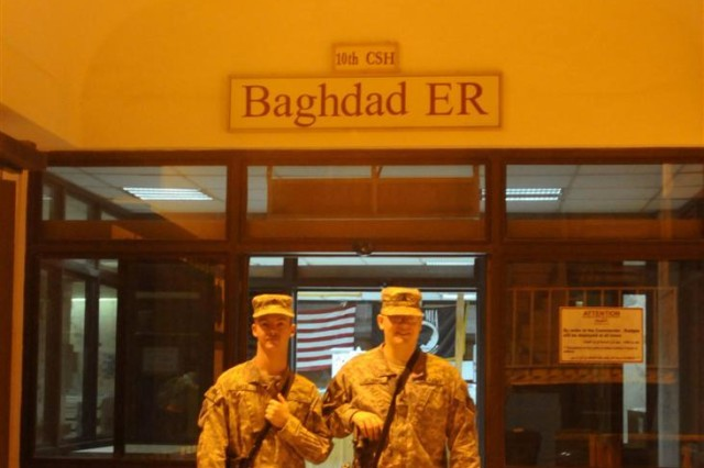 Sgt. Craig M. Smith, from Springfield, Ill., and Sgt. Matthew J.M. Jochums, from Roanoke, Ill., from the Casualty Liaison Team, 10th Sustainment Brigade, with the 10th Combat Support Hospital at Ibn Sina Hospital in Iraq, stand outside of the emergency room during a slow night. The 10th CSH, including the 623rd PSD, is scheduled to move to Sather Air Base, Iraq, in Septembe