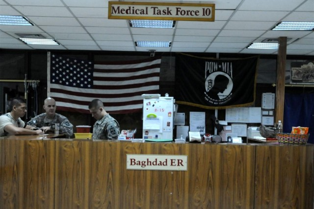 Soldiers with the 10th Combat Support Hospital at Ibn Sina Hospital in Iraq enjoy a slow night in the emergency room. The 10th CSH is scheduled to move to Sather Air Base, Iraq, in September