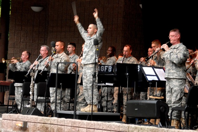 """Maj. Domingos Robinson conducts the Army Ground Forces Band at a concert in Peachtree City, Ga. The  band opened the concert with """"Festival Overture on the Star Spangled Banner."""""""
