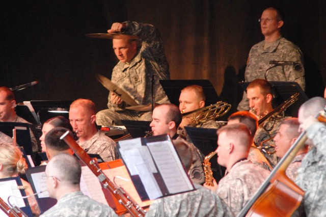 """Master Sgt. John Jacobs of the Army Ground Forces Band adds the cymbals to an upbeat and stirring rendition of """"The Fort McHenry Suite"""" composed by Julie Giroux."""