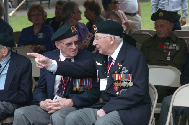 Veterans of the First Special Service Force talk before a ceremony held to honor the First Special Service Force Aug. 22 in Halifax, Canada during the Force's 63rd annual reunion. The FSSF was a World War II combined special operations force which U.S. Army Special Forces units today trace a portion of their lineage from.