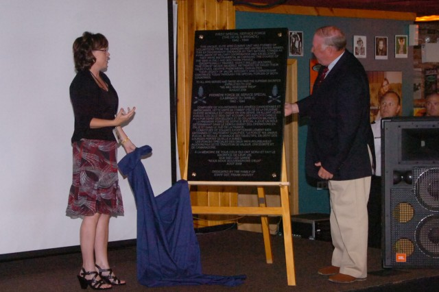 Mary Bhagan, organizer of the 63rd annual First Special Service Force reunion, and Army Museum Halifax Citadel director Bruce Gilchrist unveil a plaque to be displayed at the museum during a luncheon at Canadian Forces Base Stadacona Aug. 21 in Halifax, Canada during the Force's 63rd annual reunion.